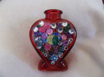 Upcycled Red Glass Bottle - Crafts | Maya Rodriguez | Touchtalent