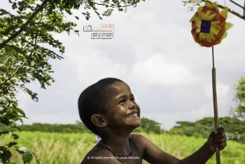 Innocent Smile - Photography | Sanjib Debnath | Touchtalent